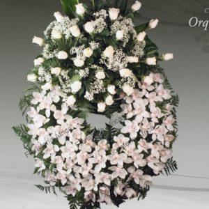 Corona floral funeraria de orquídeas